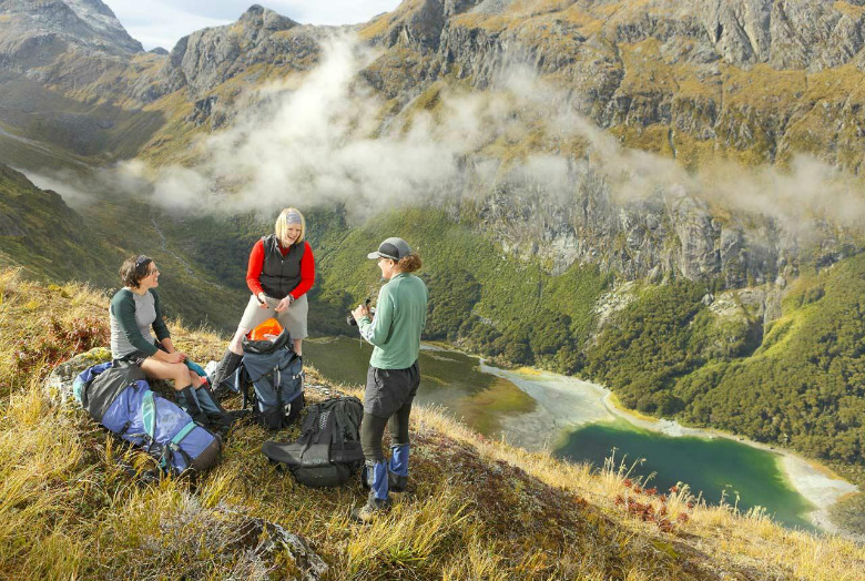 Hikers enjoying the view on the Routeburn Track