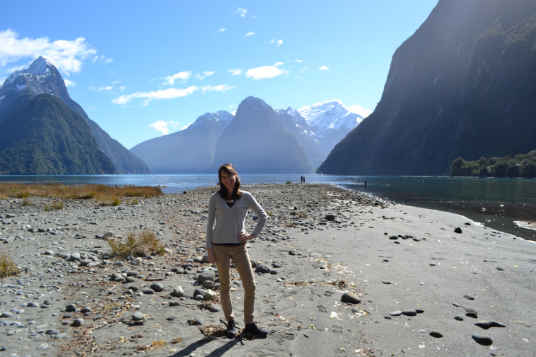 Carole standing near Sandfly Point in Milford Sound