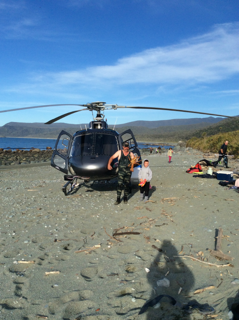 Freshly caught crayfish on your exclusive West Coast helicopter flight.