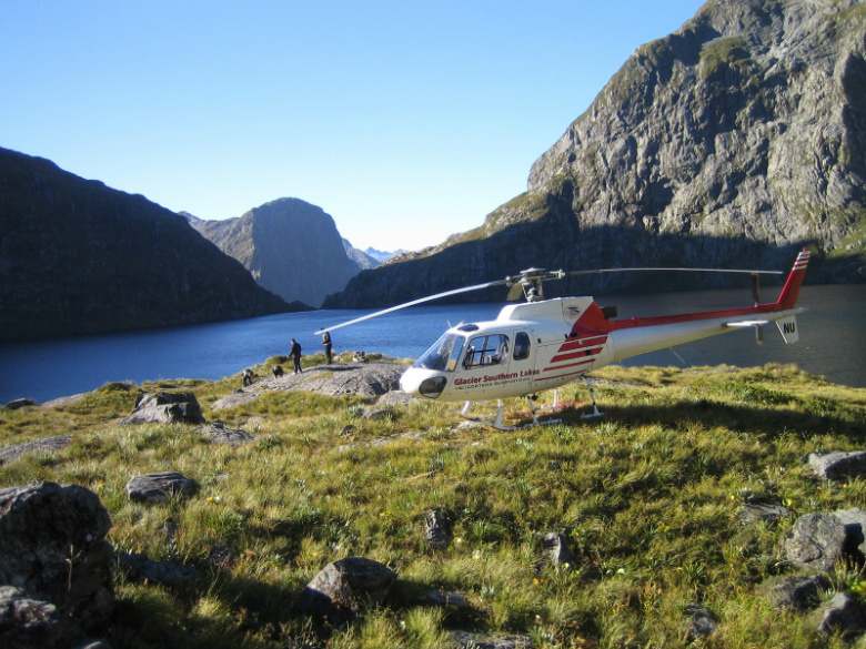 Arriving by helicopter at the spectacular Lake Quill with the Sutherland falls in the background.