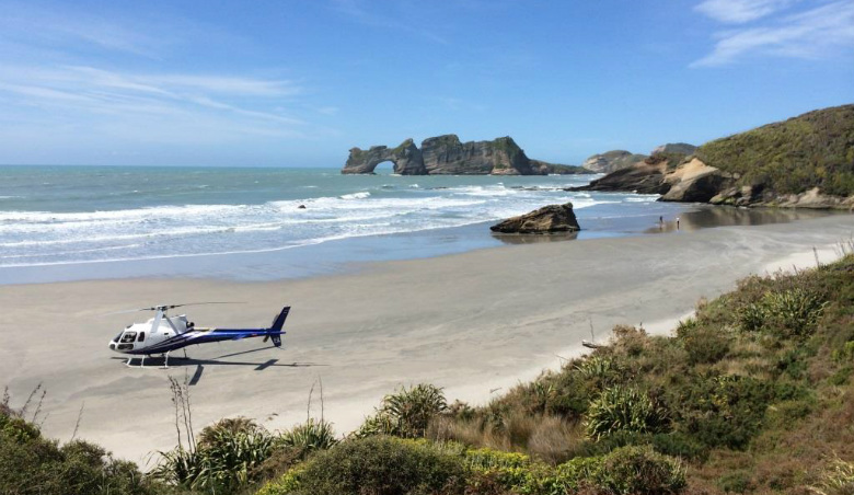 Landing the helicopter on a remote beach in Northwest New Zealand