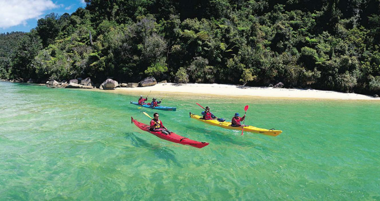 Kayaking clear waters in Abel Tasman