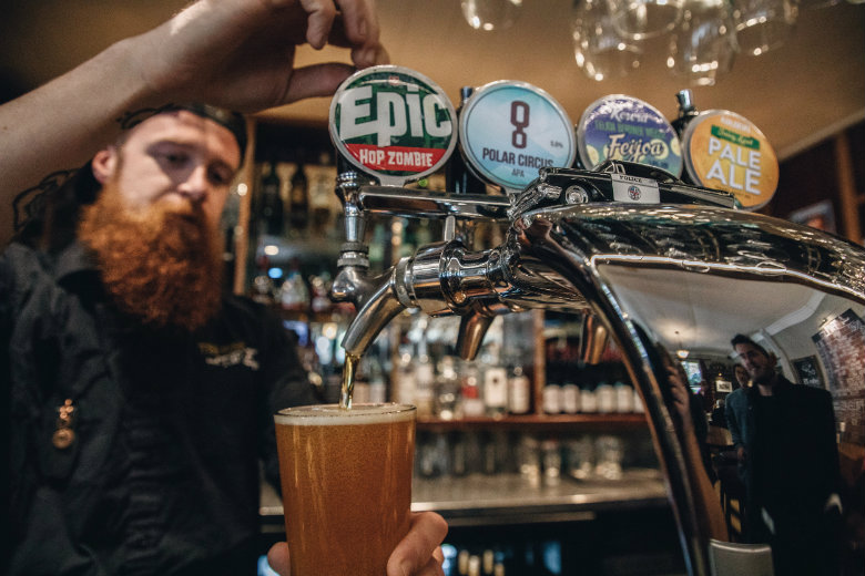 Pouring fresh craft beer from the tap in Queenstown