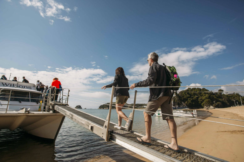 Boarding a water taxi to explore the Nelson & Abel Tasman region.