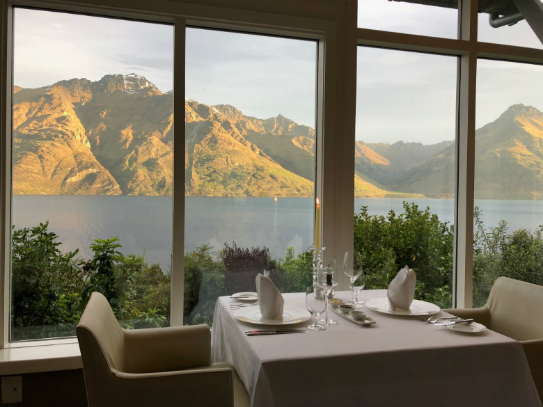Enjoying the view on their Luxury vacation at Matakauri Lodge, Queenstown