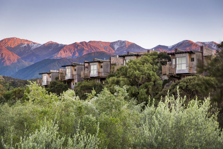 Tree Houses at Hapuku Lodge, with the Kaikoura mountains in the background.