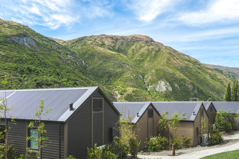 The Gibbston Valley Lodge villas with the Remarkables mountain range behind