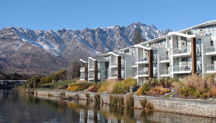 The Hilton Queenstown with Remarkables mountain range in bac